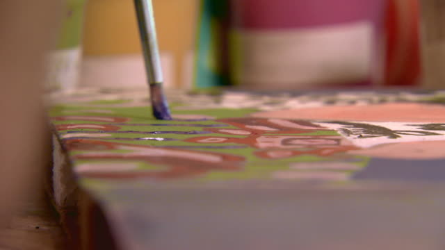 Close up of paint brush on canvas