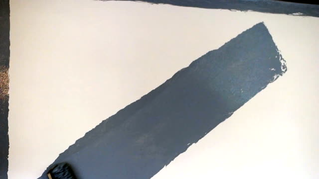 close up of painter hand painting a wall - paint roller stock videos & royalty-free footage