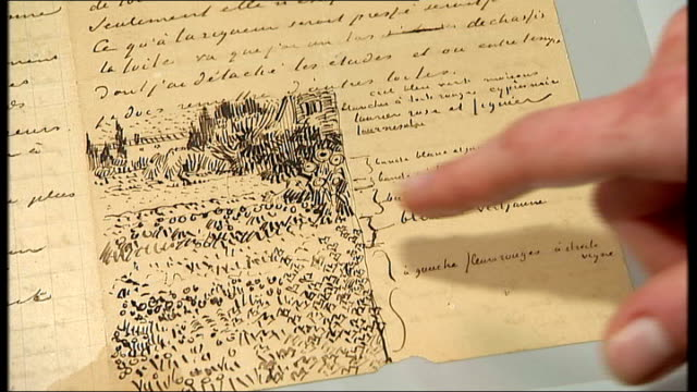 close up of painting of books with audio of letter written by van gogh overlaid sot nienke bakker and reporter looking at letter in archive finger of... - finger painting stock videos and b-roll footage