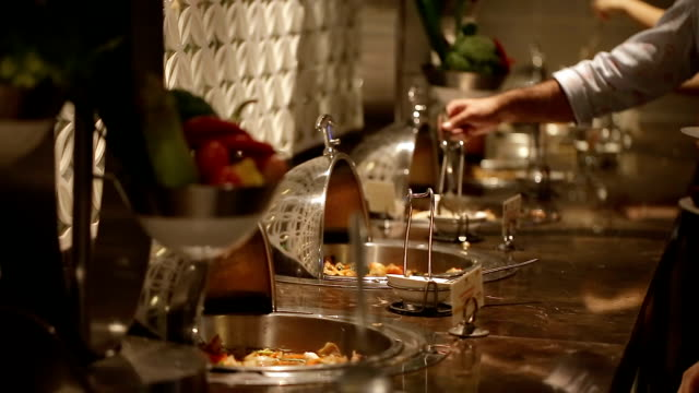 close up of people hand catering buffet food at the party. - buffet stock videos & royalty-free footage