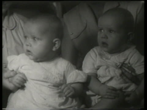 close up of people holding twin babies / canadian national exhibition / sound - babies only stock videos & royalty-free footage