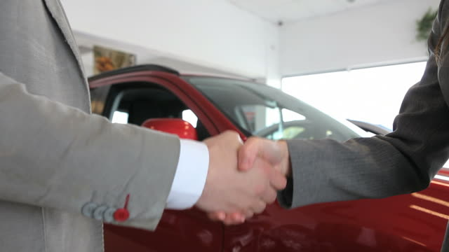Close up of people shaking hand