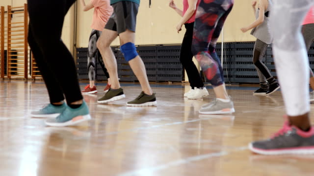 close up of people's feet dancing at zumba class - dance studio stock videos & royalty-free footage