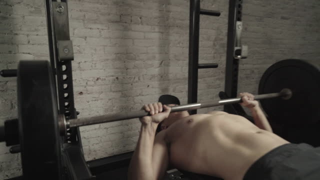 Close up of person bench pressing
