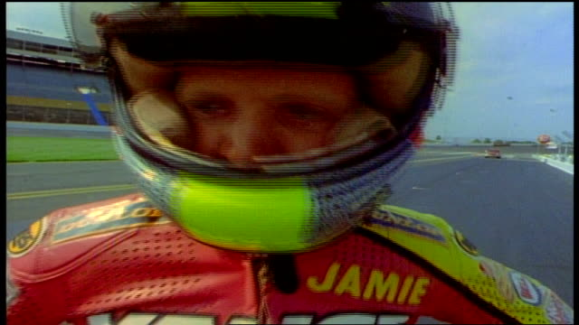 close up of person in full racing uniform and helmet - sportschutzhelm stock-videos und b-roll-filmmaterial