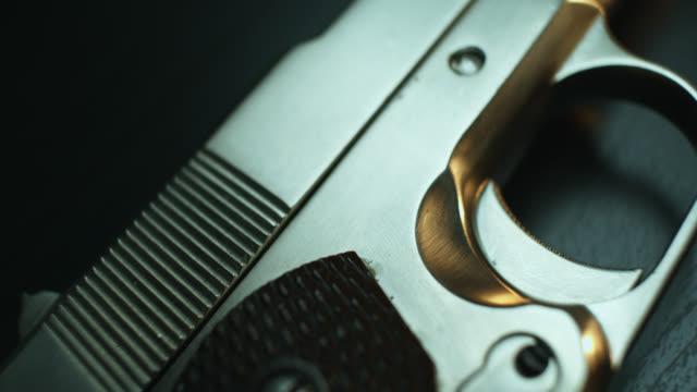 vidéos et rushes de close up of pistol - armement