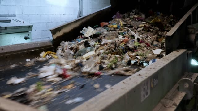 close up of plastic waste on fast moving conveyor belt - rubbish dump stock videos & royalty-free footage