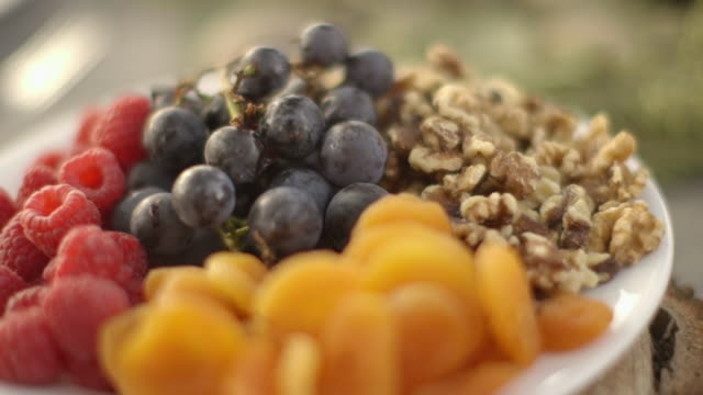 close up of plate of fruit and nuts - walnut stock videos & royalty-free footage