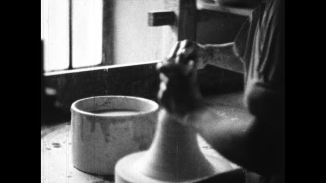 close up of pot being spun and hands working on it; artisan painting little sculptures and lining up parts; close up of hands working on spinner - pottery stock videos & royalty-free footage