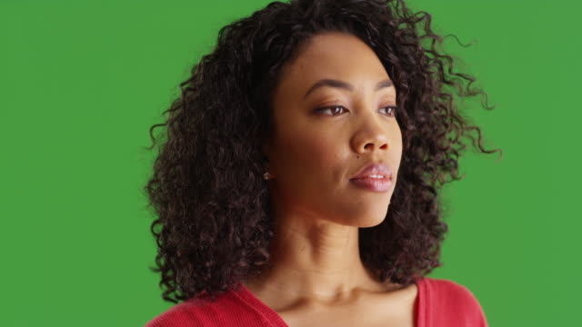 close up of pretty black woman looking wistfully to the side on greenscreen - {{asset.href}} stock videos & royalty-free footage