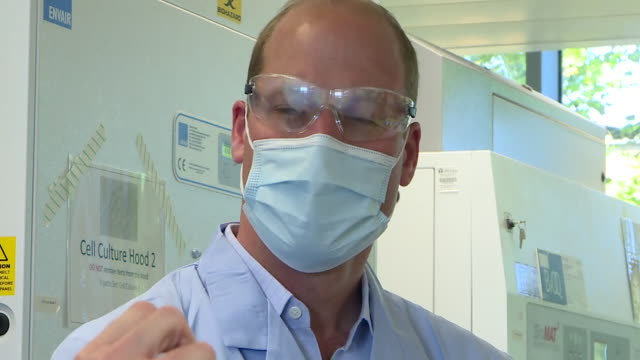 """close up of prince william wearing face mask goggles and lab coat as he visits university of oxford's covid19 oxford vaccine group researching a... - """"bbc news"""" stock videos & royalty-free footage"""