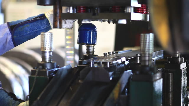 close up of punching press machine with metal plate. - pushing stock videos and b-roll footage