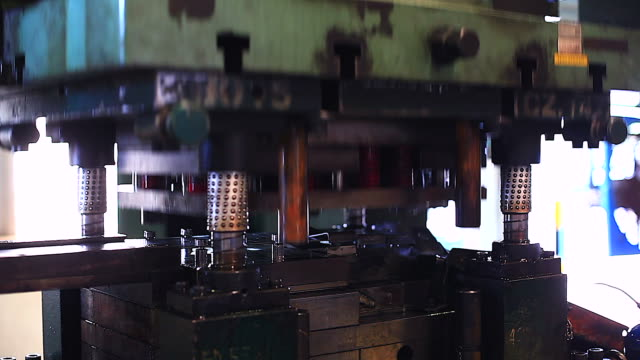 close up of punching press machine with metal plate. - pushing stock videos & royalty-free footage