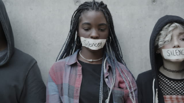 close up of quiet silenced protesters with tape covering mouths / provo, utah, united states - protestor stock videos & royalty-free footage