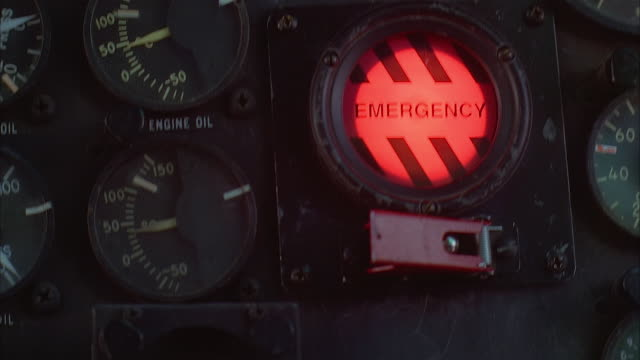 close up of red emergency light flashing on helicopter control panel - control panel stock videos & royalty-free footage