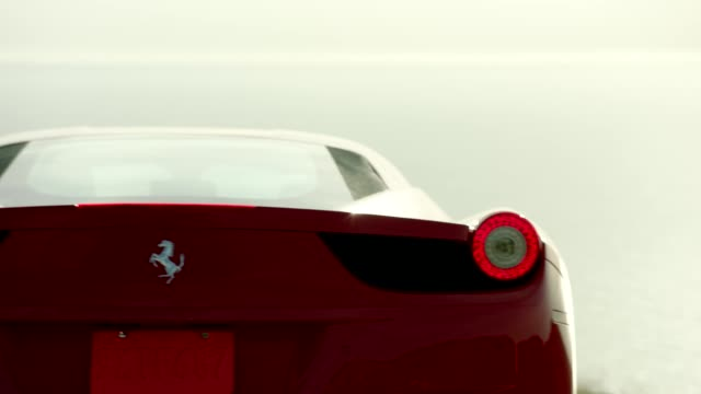close up of red ferrari driving up malibu canyon - tail light stock videos & royalty-free footage