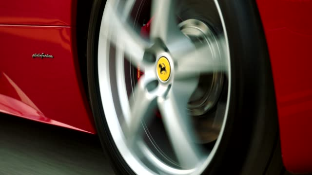 vídeos y material grabado en eventos de stock de close up of red ferrari tire driving up malibu canyon - ferrari