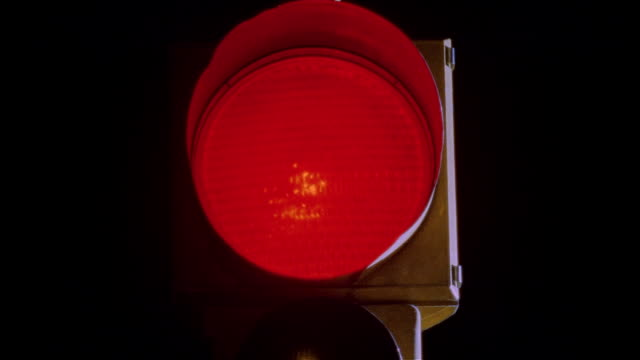 Close up of red light on traffic light / light changing