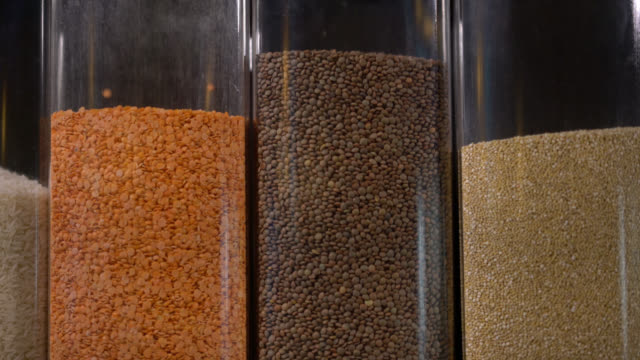 Close up of rice, beans and cereals sold by bulk at a grocery store