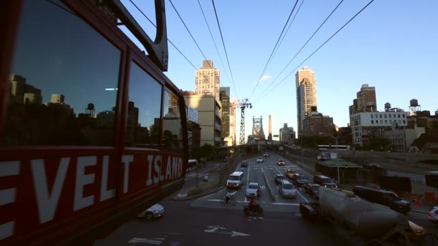 close up of roosevelt island tram departing. roosevelt island tram offers resident unique commute to and from manhattan on june 12, 2013 in new york,... - b roll stock videos & royalty-free footage