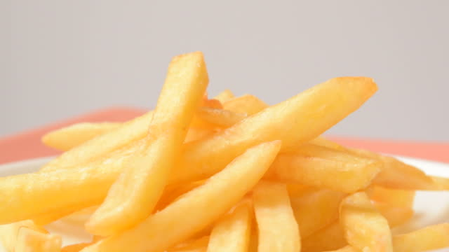Close up of rotating french Fries