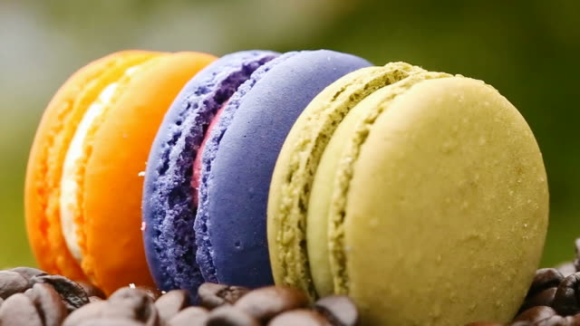close up of rotating purple ,green,orange, macaroon - macaroon stock videos and b-roll footage