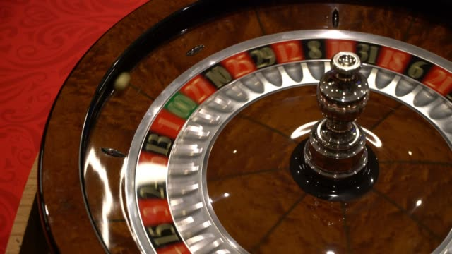 close up of roulette spinning at the casino - roulette stock videos & royalty-free footage