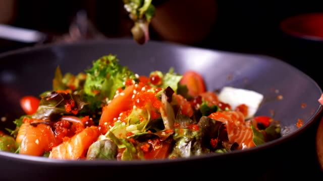 close up of salmon salad with customer while eating food - salmon salad stock videos & royalty-free footage