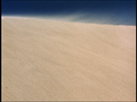 close up of sandstorm w/blue sky in background / audio - b roll stock videos & royalty-free footage