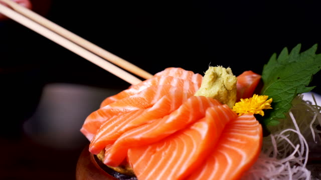 close up of sashimi salmon at japanese restaurant - seafood stock videos & royalty-free footage