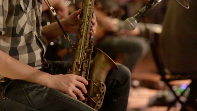 close up of saxophone players : hd vdo - saxophone stock videos and b-roll footage