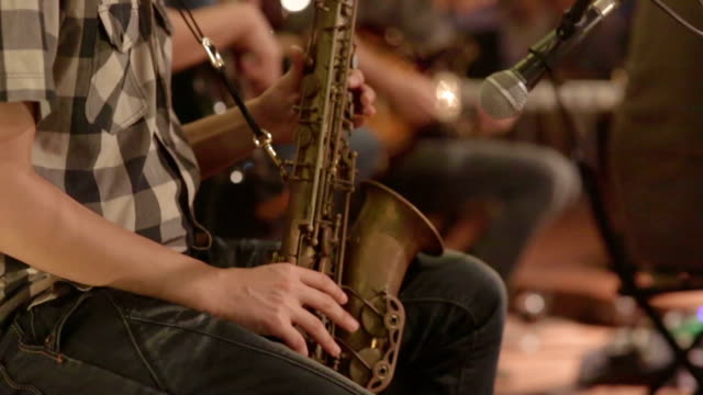 Close up of saxophone players