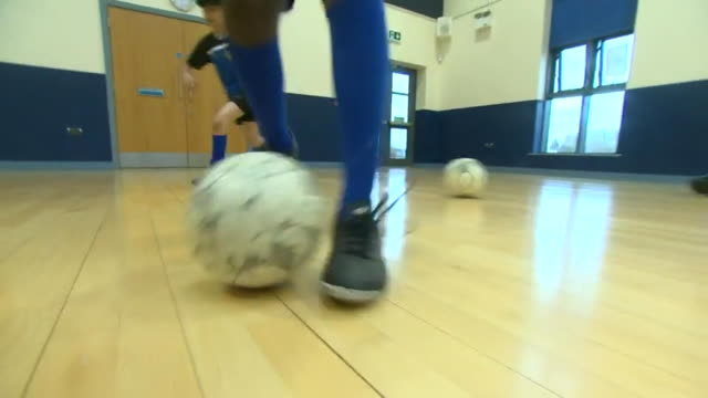 close up of schoolchild dribbling the ball during football training manchester - low angle view stock videos & royalty-free footage