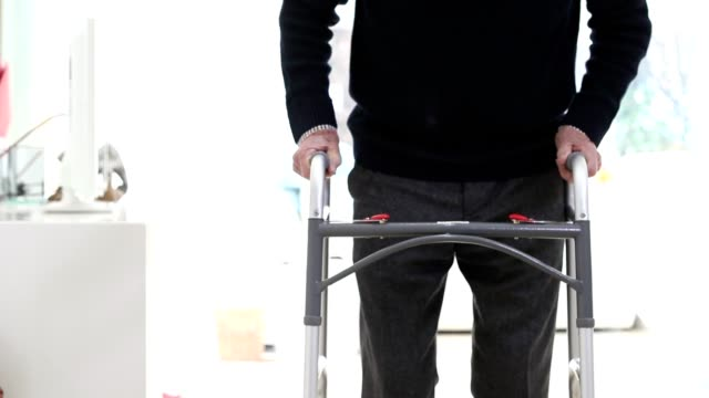 Close Up Of Senior Man Using Walking Frame At Home