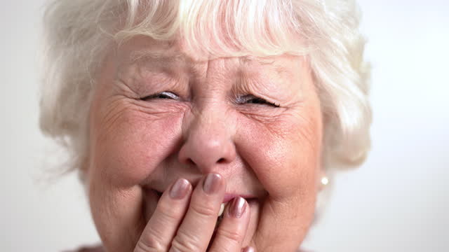 close up of senior woman laughing - one senior woman only stock videos & royalty-free footage