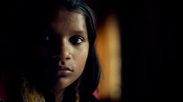 close up of serene indian girl thinking. - gente comune video stock e b–roll