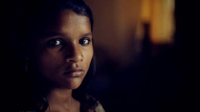 Close up of serene Indian girl thinking.