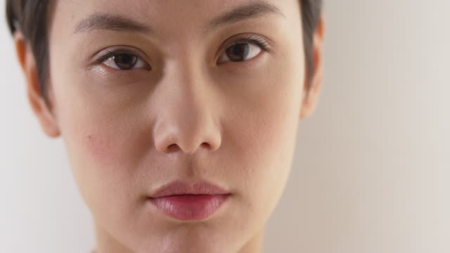 Close up of serious asian woman's face
