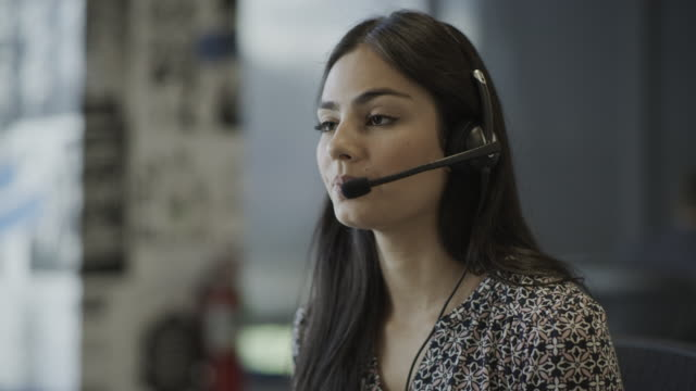 vídeos y material grabado en eventos de stock de close up of serious businesswoman wearing headset talking in call center / pleasant grove, utah, united states - call center latino