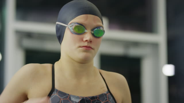 vídeos de stock, filmes e b-roll de close up of serious girl warming up before swimming / provo, utah, united states - provo