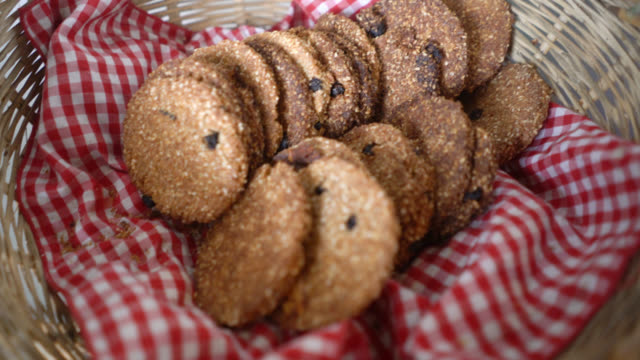 close up of sesame cookies in a basket at a bakery - basket stock videos & royalty-free footage