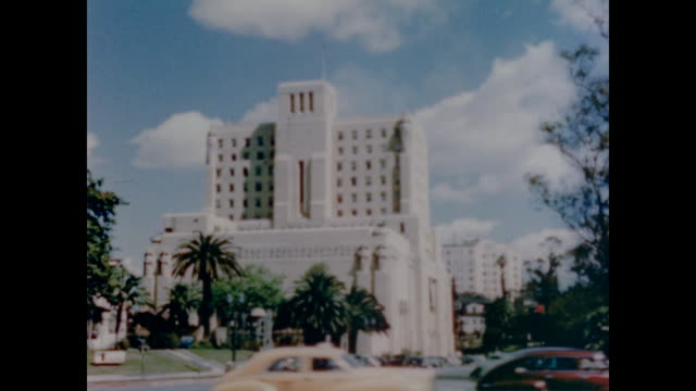 1947 close up of several buildings in downtown la include the civic center, city hall, county hall of justice, county jail, federal building, post office, county hospital, apartment hotels and the public library - 1947年点の映像素材/bロール