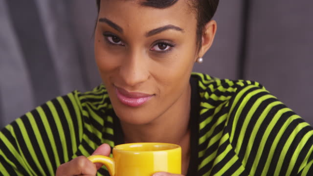 close up of sexy woman smiling with mug - puerto rican ethnicity stock videos & royalty-free footage