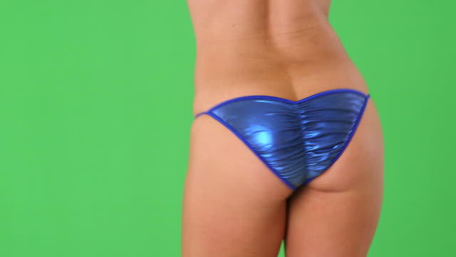close up of sexy woman's behind in blue bikini bottom  - bikini bottom stock videos & royalty-free footage