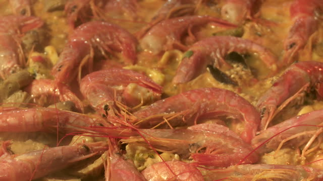 close up of shellfish cooking in a paella - prawn animal stock videos and b-roll footage