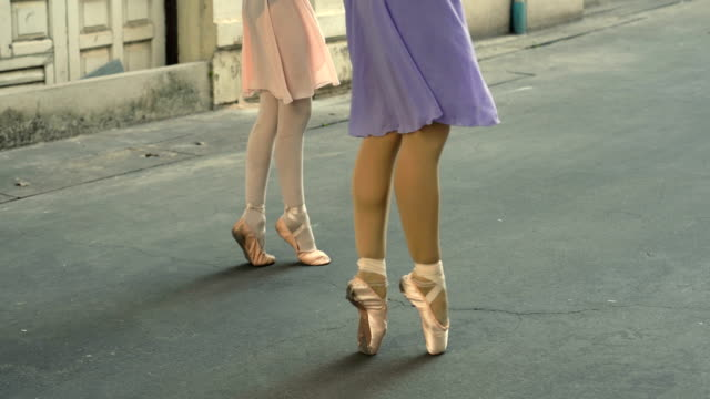 close up of shoes ballerina dancing along the street - ballet shoe stock videos & royalty-free footage