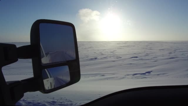 close up of side-mirror as a car drives around the north slope in prudhoe bay, ak on february 17, 2017. for 4k footage:... - team photo stock videos & royalty-free footage