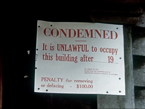 1956 close up of sign condemning building - condition stock videos & royalty-free footage