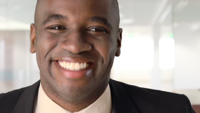 Close up of smiling African-American Businessman