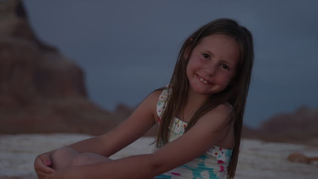 close up of smiling girl on beach at night / lake powell, utah, united states - lake powell stock videos & royalty-free footage